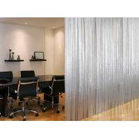 A set of metallic fabric cloth is installed on the ceiling to divide a meeting room.