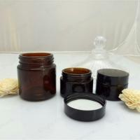 Wholesale Face cream amber glass jar with black plastic cap from china suppliers