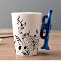 Wholesale Creative two tone color glazed ceramic V Shaped Mug with musical instrument handle from china suppliers