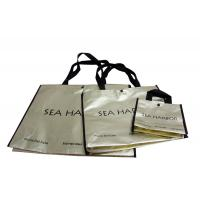 75g gold shining & black logo and binding , nylon tape handle unwoven fabric carrier bags