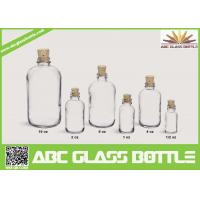 Wholesale 1/2oz 1oz 2oz 4oz 8oz 16oz Hot sale clear or frosted boston round glass bottle with Cork cap from china suppliers