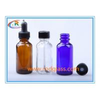 Wholesale 1oz Amber glass bottle Boston Round with black phenolic cone lined cap from china suppliers