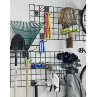 Two black grid panels with sports equipment and garden tools