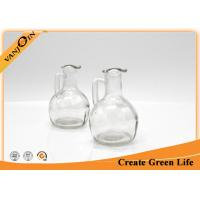 Wholesale 150ml Cute Round Glass Sauce Bottles With Handle for Oil Storing from china suppliers