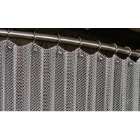 Metal coil curtain on the stainless steel rod fixed with rings and screws.