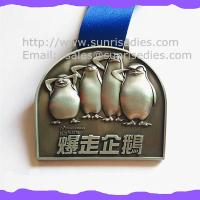 Wholesale 3D engraved penguin medals, OEM zinc alloy 3D metal medal with ribbon China from china suppliers