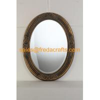 Wholesale Antique gold finish PU framed oval shaped wall mirror with carved flowers and bevelled mirror from china suppliers