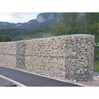 Gabion noise barriers filled with rocks are mounted along the highway to control the traffic noises