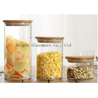 Wholesale blown high borosilicate glass storage jar with wooden lid sale from china suppliers
