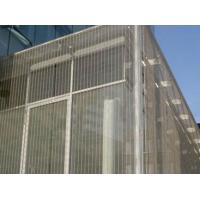 The building exterior surface is covered by the cable metal meshes.