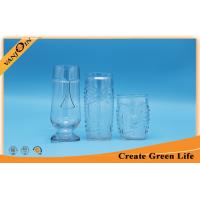 Wholesale 600ml Tiki Relief Clear Glass Beverage Bottles With Glass Stand from china suppliers